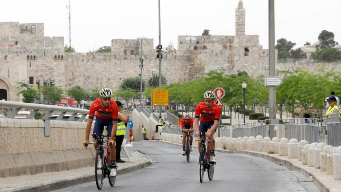 Italian cyclist Niccolo Bonifazio (R) of Bahrain Merida team and teammates warm up along the walls of Jerusalem's old city before the start of the first stage of the Giro d'Italia cycling race, a 9.7km individual time trial in Jerusalem, Israel, 04 May 2018. Abir Sultan / EPA
